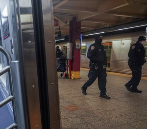 Police patrol the A line subway train bound to Inwood, after NYPD deployed an additional 500 officers into the subway system following deadly attacks, Saturday Feb. 13, 2021, in New York.