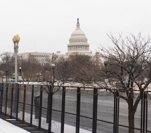 The U.S. Capitol is seen behind the metal security fencing around the U.S. Capitol, Thursday, Feb. 18, 2021.