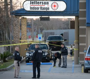 Jefferson Parish Sheriff's Office and Bureau of Alcohol, Tobacco, Firearms and Explosives: ATF investigators look at evidence at the scene of a multiple fatality shooting at the Jefferson Gun Outlet in Metairie, La.
