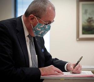 Gov. Phil Murphy signs legislation into law.
