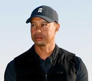Golf star Tiger Woods was extricated from his vehicle after a rollover crash in Los Angeles County on Tuesday.