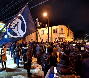 A crowd gathers near the site of Daniel Prude's encounter with police officers in 2020, in Rochester, N.Y., Tuesday, Feb. 23, 2021.