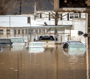 Floodwaters cover a parking lot in Paintsville, Ky. on Monday, March 1, 2021, following severe thunderstorms. First responders performed numerous water rescues and a state of emergency was declared in Kentucky due to the flooding.