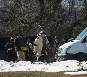 Ankeny Police investigate the scene at the Lakeside Center where a suspicious package was found on Tuesday, March 2, 2021, in Ankeny, Iowa.