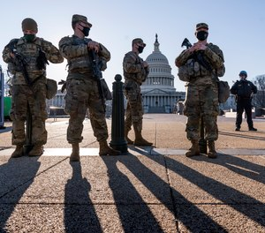 Members of the Michigan National Guard and the U.S. Capitol Police keep watch as heightened security remains in effect around the Capitol grounds since the Jan. 6 attacks by a mob of supporters of then-President Donald Trump, in Washington, Wednesday, March 3, 2021.