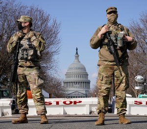 National Guard keep watch on the Capitol, Thursday, March 4, 2021, on Capitol Hill in Washington.
