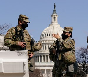 National Guard stand guard at the Capitol in Washington, Thursday, March 4, 2021.