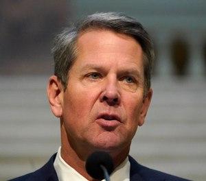 In this Dec. 8, 2020, file photo, Georgia Gov. Brian Kemp speaks to reporters in the Capitol in Atlanta.