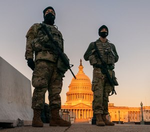 National Guard stand their posts around the Capitol at sunrise in Washington, Monday, March 8, 2021.