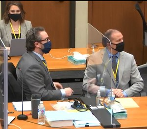 In this image from video, defense attorney Eric Nelson left, and defendant, former Minneapolis police officer Derek Chauvin, right, listen as Hennepin County Judge Peter Cahill presides over jury selection in Chauvin's trial, Tuesday, March 9, 2021 at the Hennepin County Courthouse in Minneapolis.