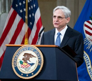 President Joe Biden's pick for attorney general Merrick Garland, addresses staff on his first day at the Department of Justice, Thursday, March 11, 2021, in Washington.