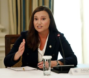 In this June 8, 2020 file photo, Florida Attorney General Ashley Moody speaks during a roundtable discussion at the White House in Washington.