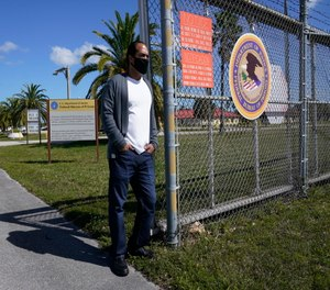 Kareen Troitino stands outside the Federal Corrections Institution in Miami.