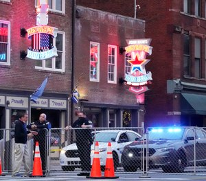 In this Dec. 28, 2020 file photo, police block off a part of the Broadway tourist district as a result of a bombing that took place on Christmas Day in Nashville, Tenn.