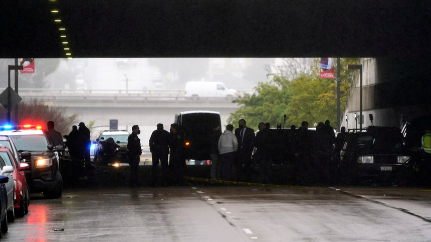 Emergency crews work at the scene of a deadly accident Monday, March 15, 2021, in San Diego. (AP Photo/Gregory Bull)