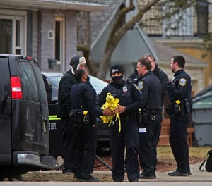 Milwaukee Police Officers and other investigators work near the intersection of North 92nd and West Townsend streets in Milwaukee, Wednesday, March 17, 2021.