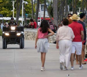 A police officer on an ATV patrols in Miami Beach, Florida's famed South Beach, Monday, March 22, 2021.