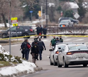 Police work on the scene near a King Soopers grocery store where a shooting took place Monday, March 22, 2021, in Boulder, Colo.