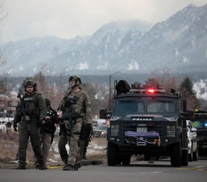 Police work on the scene outside of a King Soopers grocery store where a shooting took place Monday, March 22, 2021, in Boulder, Colo.