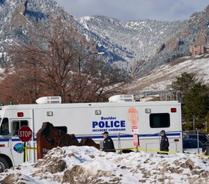 Police head into the parking lot outside a King Soopers grocery store where a mass shooting took place Tuesday, March 23, 2021, in Boulder, Colo.