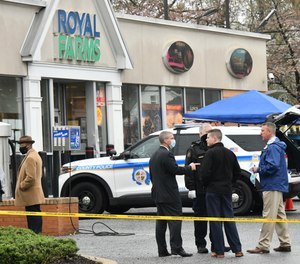 Baltimore County police investigate a shooting Sunday, March 28, 2021 at the Royal Farms in Essex, Md.