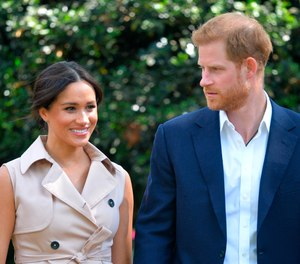 In this Oct. 2, 2019, file photo, Prince Harry and Meghan Markle appear at the Creative Industries and Business Reception at the British High Commissioner's residence in Johannesburg.