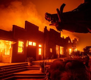 This photo shows flames from the Kincade Fire consuming a building in Healdsburg, Calif. in 2019. Pacific Gas & Electric now faces 33 criminal charges in relation to the wildfire that injured six firefighters.