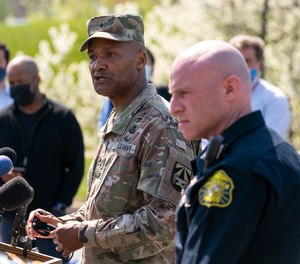Brig. Gen. Michael J. Talley, commander of U.S. Army Medical Research and Development Command Fort Detrick, Md., left, joined by Frederick Maryland Police Chief Jason Lando, right, speaks during a news conference near the scene of a shooting at a business park in Frederick, Md., Tuesday, April 6, 2021.