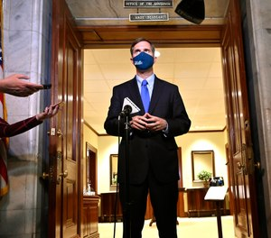 Kentucky Gov. Andy Beshear speaks to reporters at the Kentucky State Capitol in Frankfort, Ky., Wednesday, April 7, 2021.