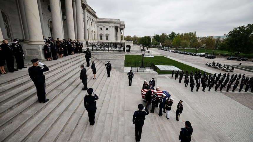 """An honor guard carries the flag-draped casket of slain U.S. Capitol Police officer William """"Billy"""" Evans up the Capitol steps to the Capitol rotunda where he will lie in honor Tuesday, April 13, 2021 in Washington."""