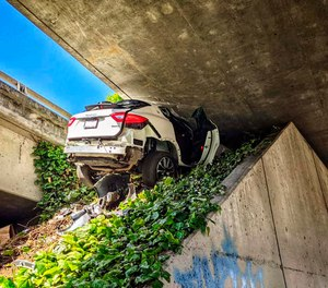 This photo shows the scene where a man fleeing from the CHP totaled his girlfriend's Maserati SUV after he careened up an embankment and slammed into the underside of an overpass.