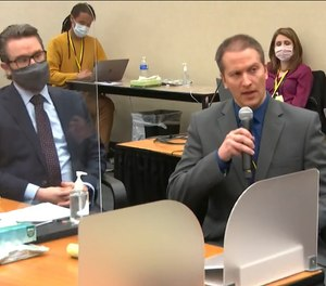 In this image from video, defense attorney Eric Nelson, left, and defendant, former Minneapolis police officer Derek Chauvin address Hennepin County Judge Peter Cahill during motions before the court Thursday, April 15, 2021, in the trial of Chauvin, at the Hennepin County Courthouse in Minneapolis.