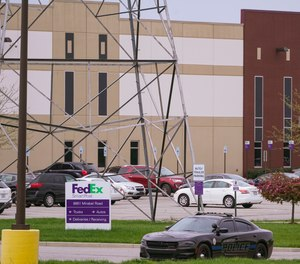 A sheriff's car blocks the entrance to the FedEx facility in Indianapolis, Saturday, April 17, 2021 where eight people were killed during a shooting late Thursday.