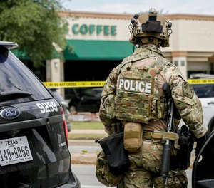 Austin police, SWAT and medical personnel respond to an active shooter situation located Great Hills Trail in Northwest Austin, Texas, on Sunday, April 18, 2021.