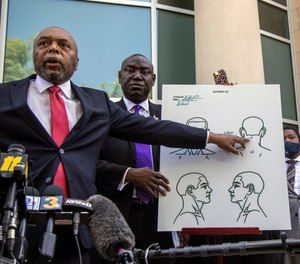 Attorneys for the family of Andrew Brown Jr., Wayne Kendall, left, and Ben Crump hold a news conference Tuesday, April 27, 2021 outside the Pasquotank County Public safety building in Elizabeth City, N.C., to announce results of the autopsy they commissioned.