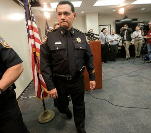In this June 8, 2017, file photo, Harris County Sheriff Ed Gonzalez leaves a news conference, in Houston.