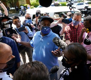 Elijah Dillard, center, is surrounded by media as he makes comments after a judges decision on the release body cam video of the shooting of Andrew Brown Jr. in Elizabeth City, N.C., Wednesday, April 28, 2021.