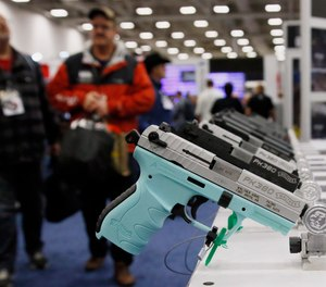 In this May 4, 2018, file photo, handguns are on display at the The National Rifle Association convention in Dallas.