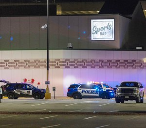 Police line the parking lot outside the Oneida Casino in the early morning hours of Sunday, May 2nd, 2021, near Green Bay, Wisconsin.