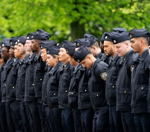 Police officers line the street as the funeral procession of New York police officer Anastasios Tsakos leaves the St. Paraskevi Greek Orthodox Shrine Church, Tuesday, May 4, 2021, in Greenlawn, N.Y.