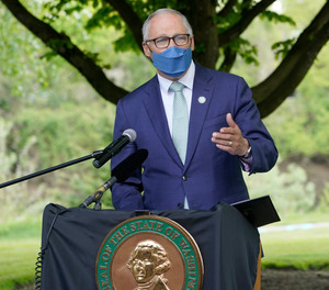 Washington Gov. Jay Inslee speaks before signing a bill into law in Tukwila, Wash., Tuesday, May 4, 2021, that levies a new capital gains tax on high profit stocks, bonds and other assets for some residents of Washington state.