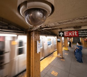 In this Oct. 7, 2020, file photo, a video surveillance camera is installed on the ceiling above a subway platform in the Court Street station in the Brooklyn borough of New York.