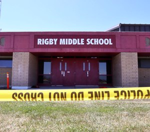 Police tape marks a line outside Rigby Middle School following a shooting there earlier Thursday, May 6, 2021, in Rigby, Idaho.