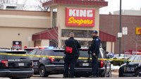 Report details police wounding of suspect in Colo. mass shooting