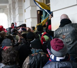 n this Jan. 6, 2021 file photo Trump supporters try to open a door of the U.S. Capitol as they riot in Washington.