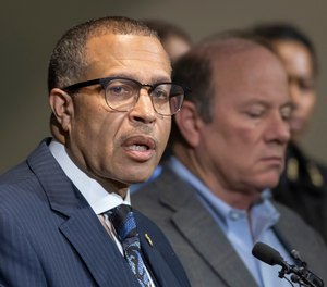 In this Nov. 21, 2019, file photo, Detroit Police Chief James Craig, left, speaks at Detroit Public Safety Headquarters.