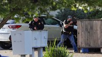 1 Calif. officer killed, 1 wounded while serving warrant; gunman dead