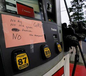 This photo shows a sign at a gas pump in Charlotte, N.C., showing the station is out of all grades of fuel after the shutdown of a major pipeline last week. Emergency services officials in Greene County, N.C., say they have had to make some changes in order to conserve fuel amid the shortage.