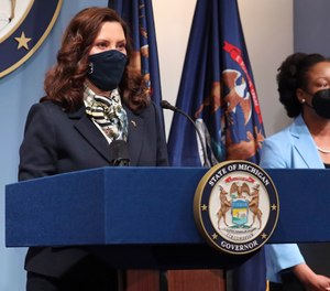 Michigan Gov. Gretchen Whitmer (left) vetoed a bill that would have allowed local government officials in more municipalities to also serve as first responders.