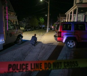 Providence police say several dozen shots were fired at a home on Thursday night, leaving nine people wounded. Three of the patients were seriously injured.